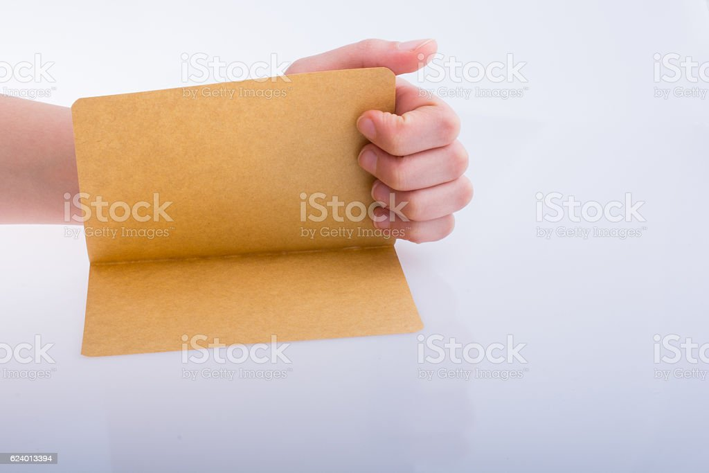 Hand holding a paper stock photo