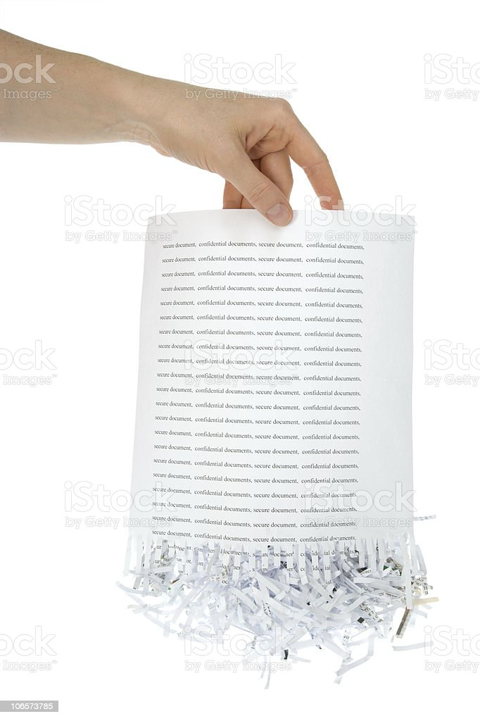 Hand holding a paper that was shredded at the bottom royalty-free stock photo