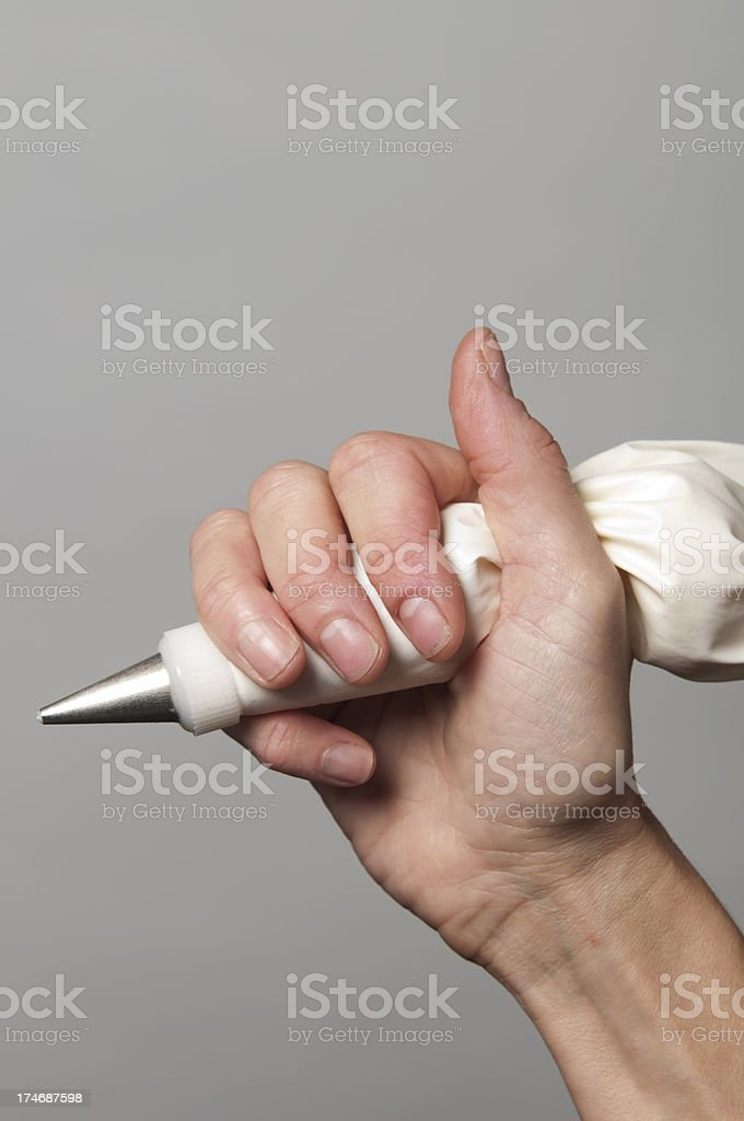 Hand holding a pastry bag stock photo