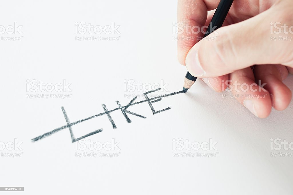 Hand Holding A Pencil Deleting Like royalty-free stock photo