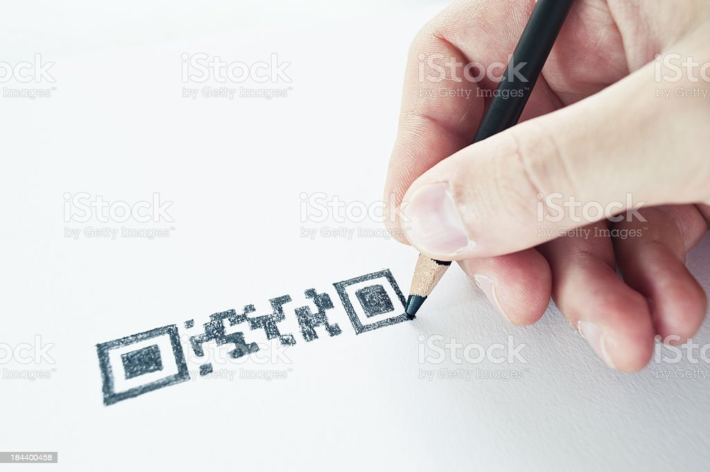 Hand Holding A Pencil Drawing QR Code royalty-free stock photo