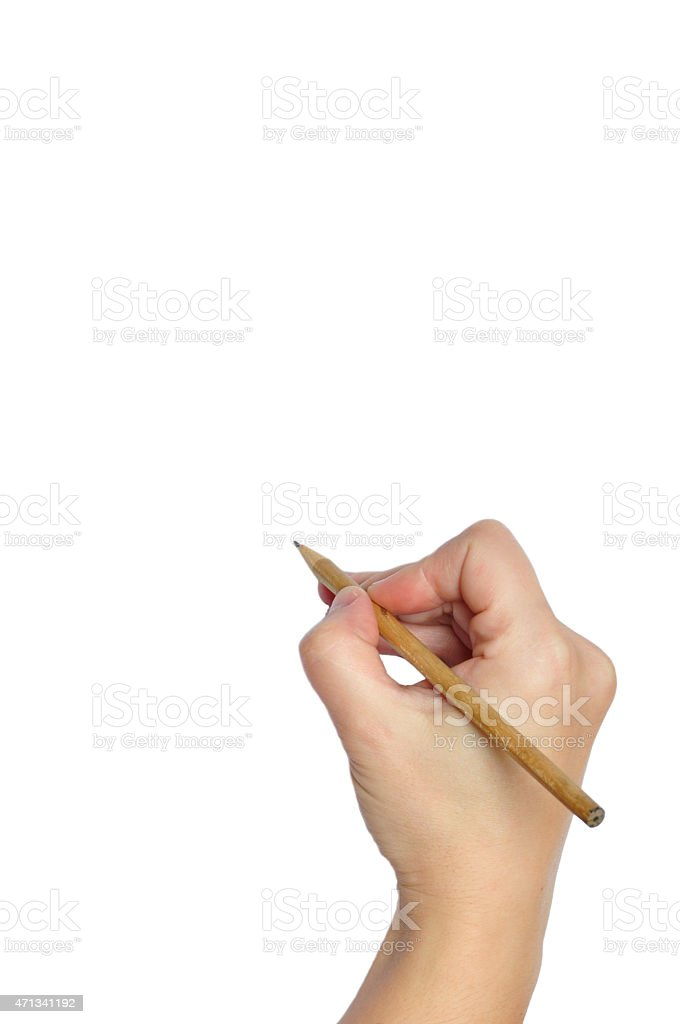 A hand holding a pencil ready to write on black page stock photo