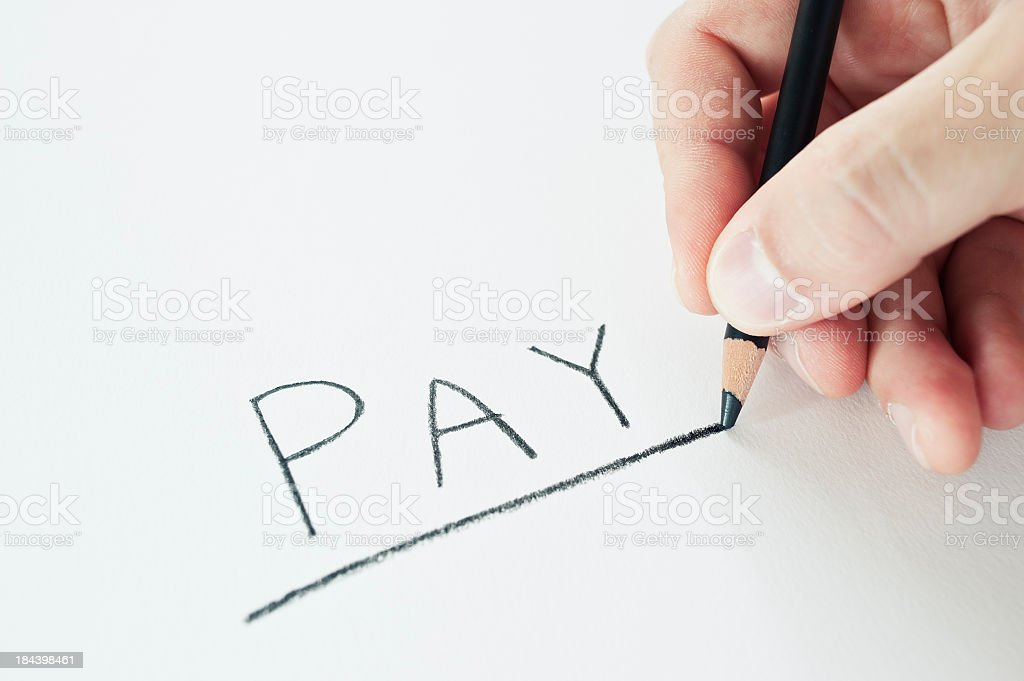 Hand Holding A Pencil Writing Pay royalty-free stock photo