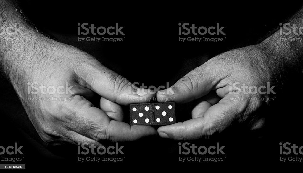 Hand holding a piece of domino royalty-free stock photo