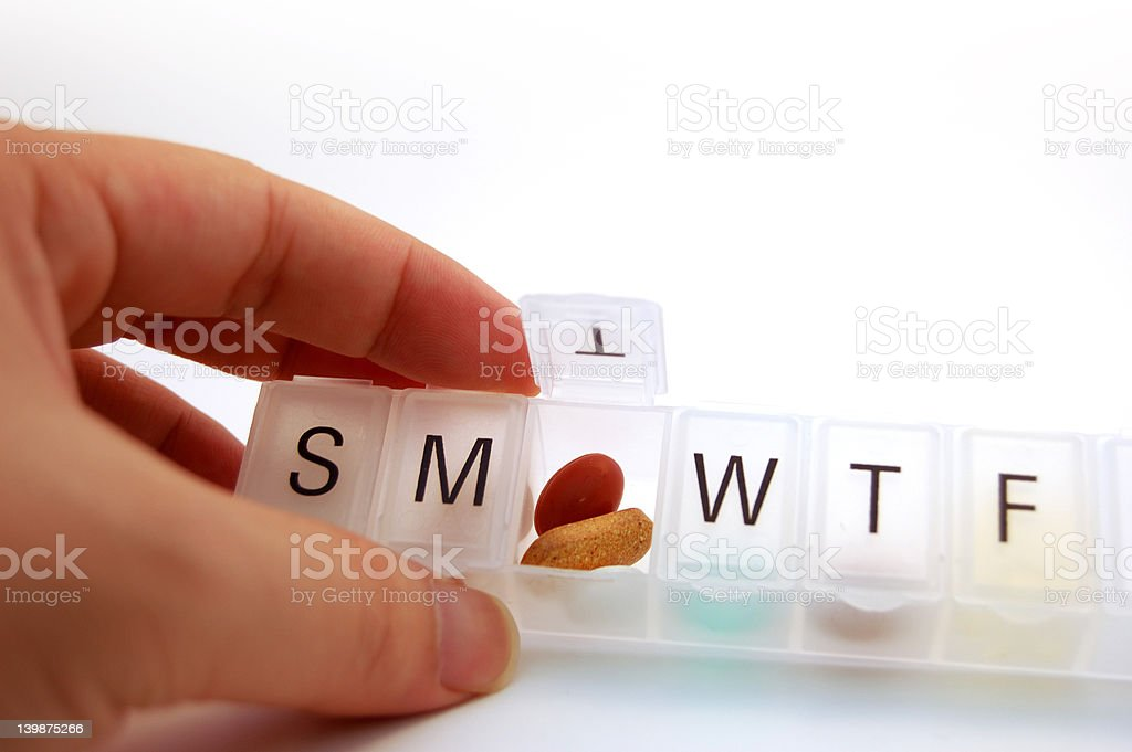 Hand holding a pill box royalty-free stock photo