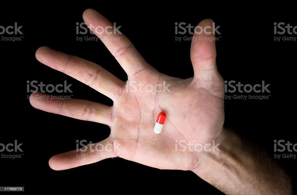 Hand holding a pill royalty-free stock photo