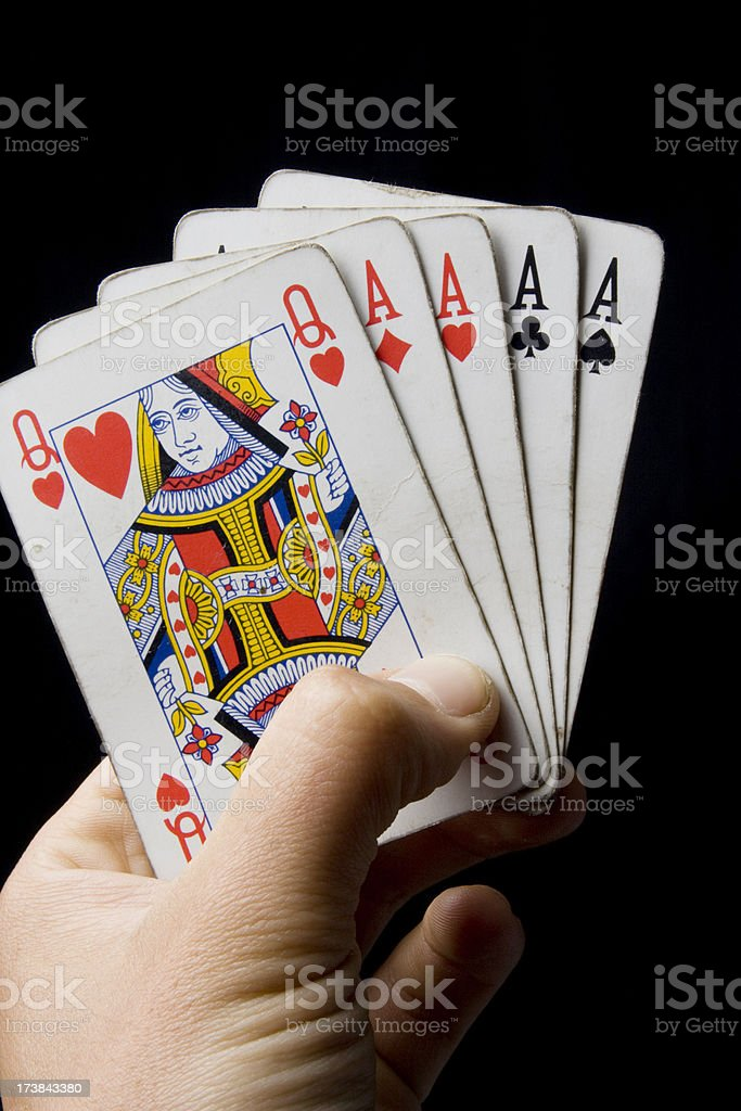 hand holding a poker royalty-free stock photo