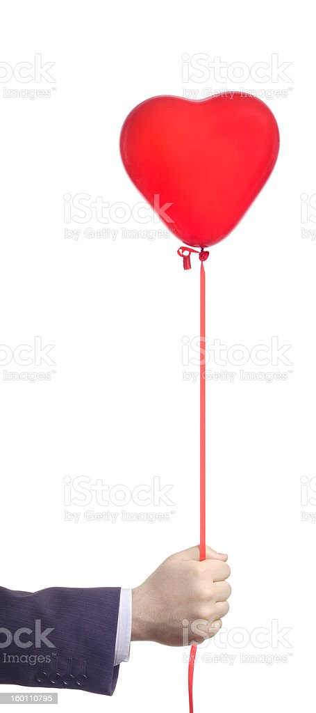 Hand holding a red balloon royalty-free stock photo