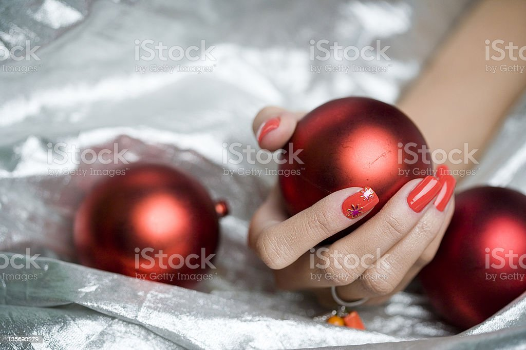 hand holding a red globe stock photo