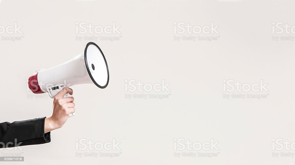 hand holding a red megaphone stock photo
