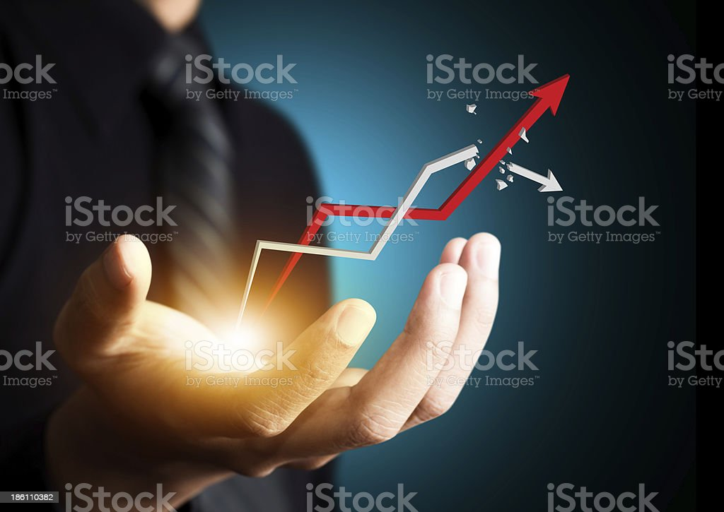 Hand holding a rising growth arrow stock photo