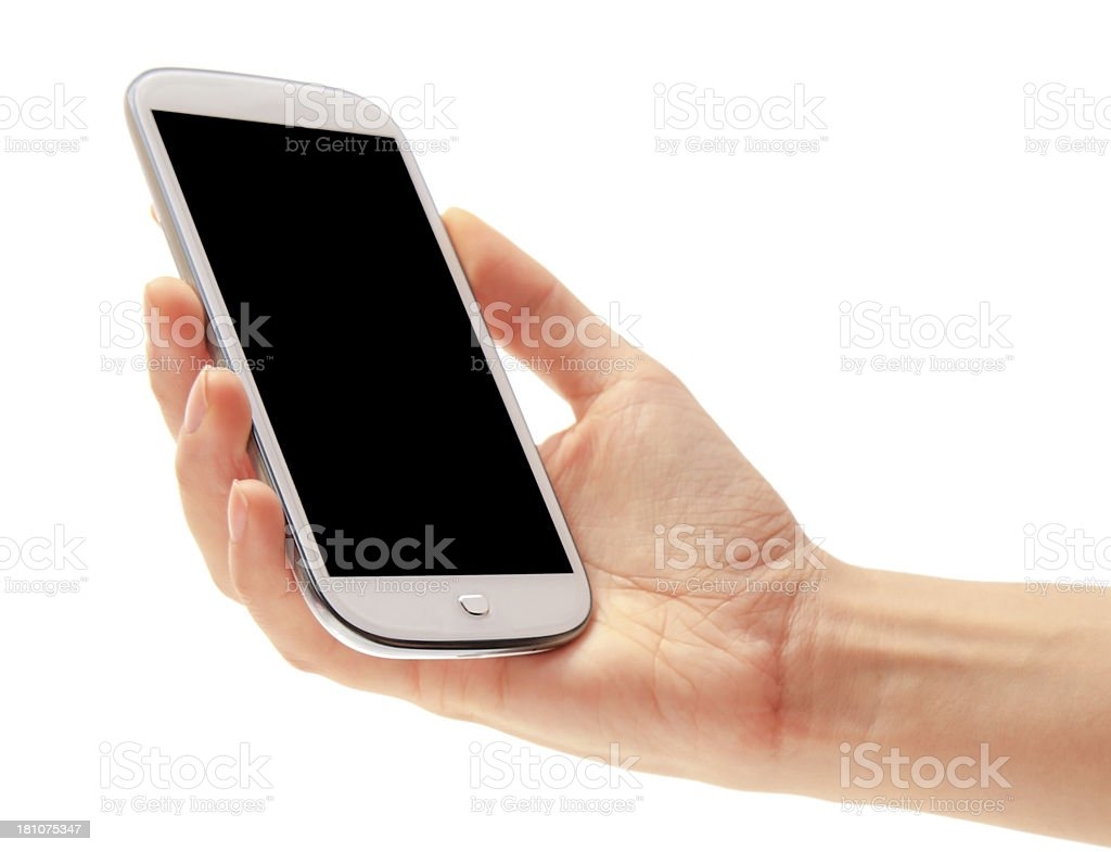 Hand holding a smartphone against a white background stock photo