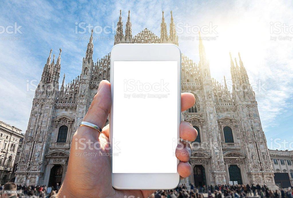 Hand holding a smartphone - Duomo Milano stock photo