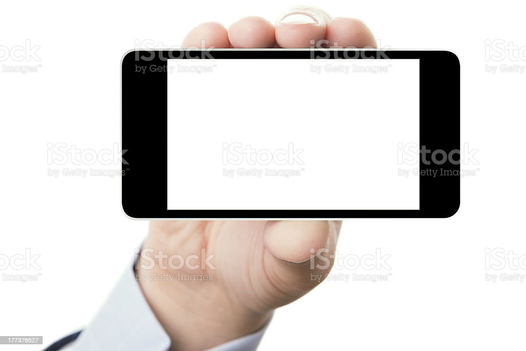 A hand holding a smartphone landscape with a white screen stock photo
