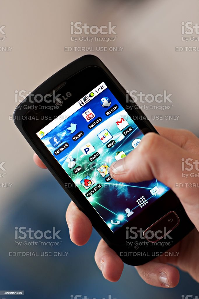 Hand holding a smartphone. stock photo