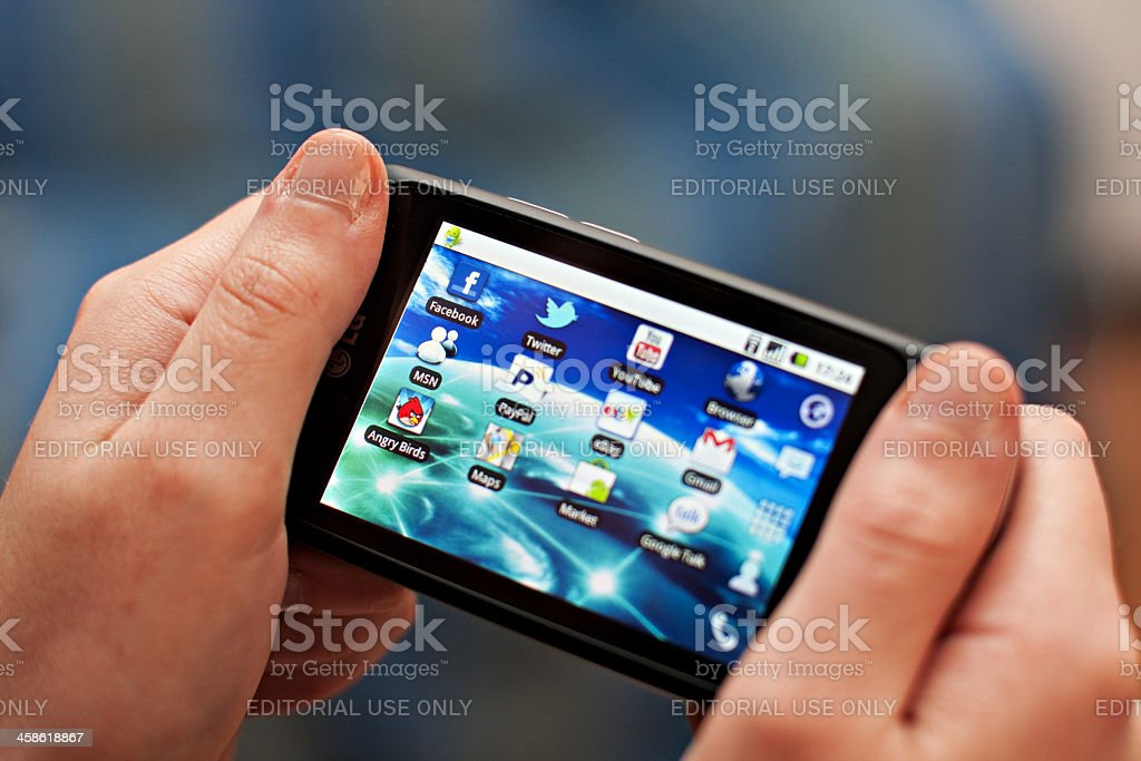 Hand holding a smartphone. royalty-free stock photo
