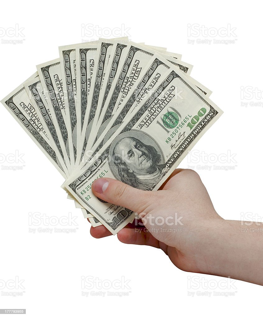 Hand holding a stack of cash stock photo