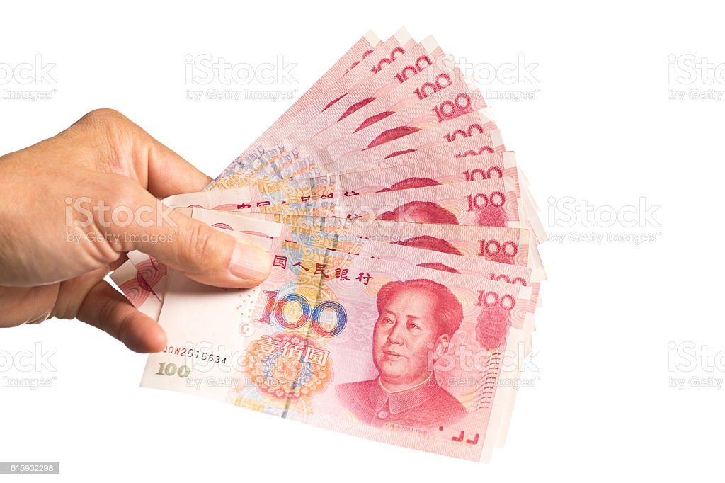 Hand Holding a Stack of Chinese Currency, 100 Yuan stock photo