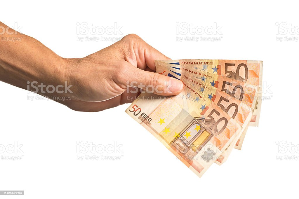 Hand Holding a Stack of European Currency, 50 Euros stock photo