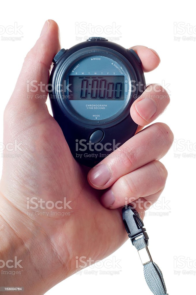 Hand holding a stop watch stock photo