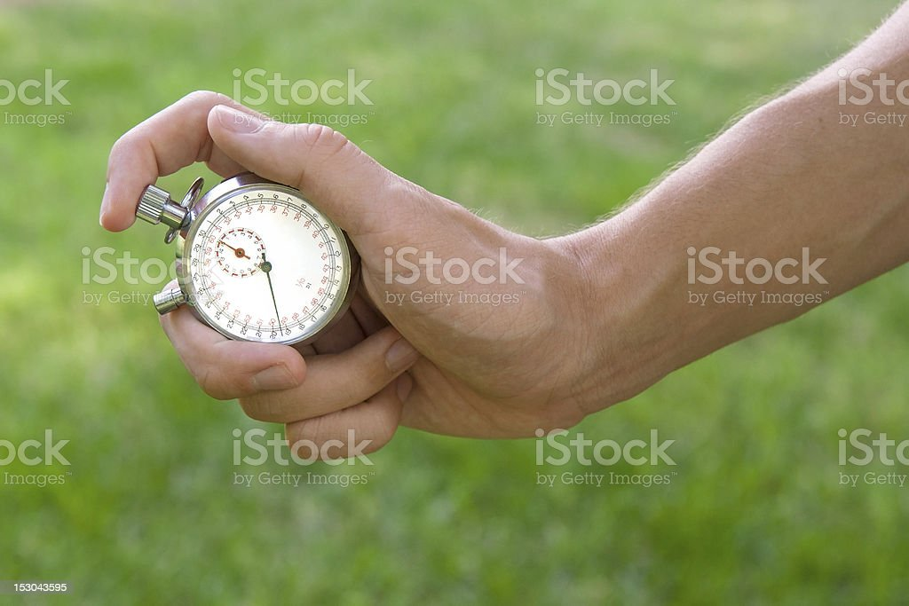 Hand holding a stopwatch royalty-free stock photo