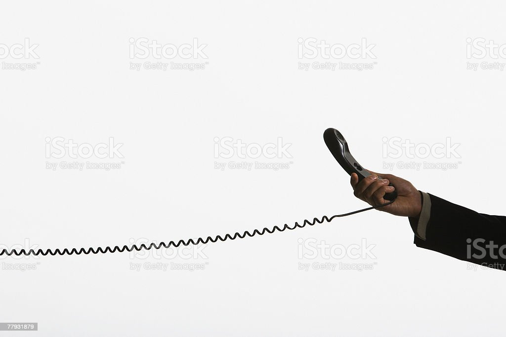 Hand holding a telephone royalty-free stock photo