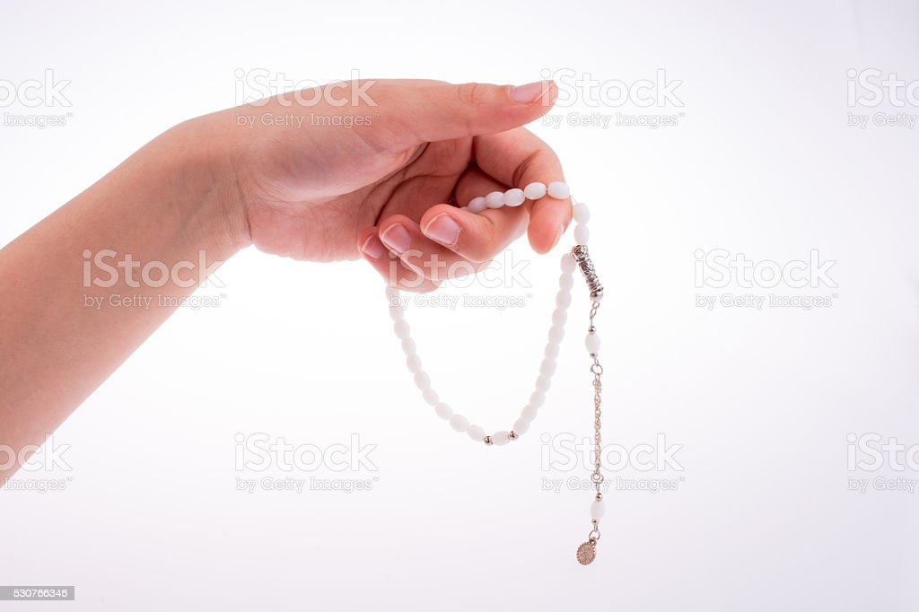 Hand holding a tespih stock photo