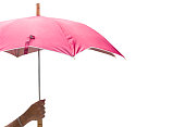 Hand holding a umbrella  isolated on white background. This has