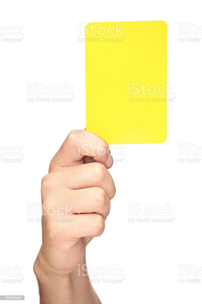 Hand holding a yellow card stock photo