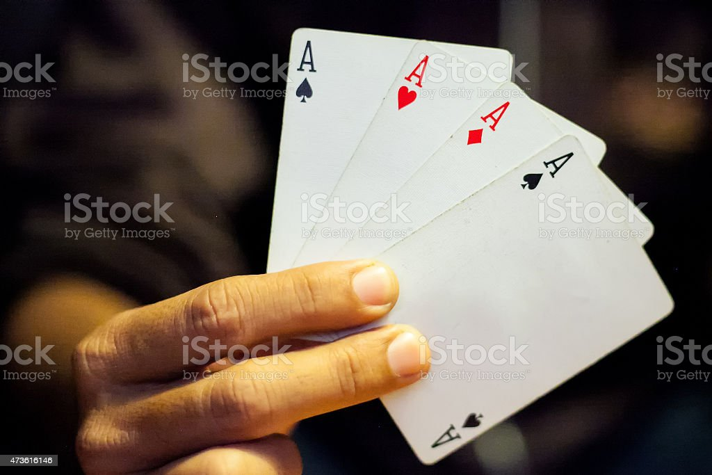 Hand holding aces card stock photo