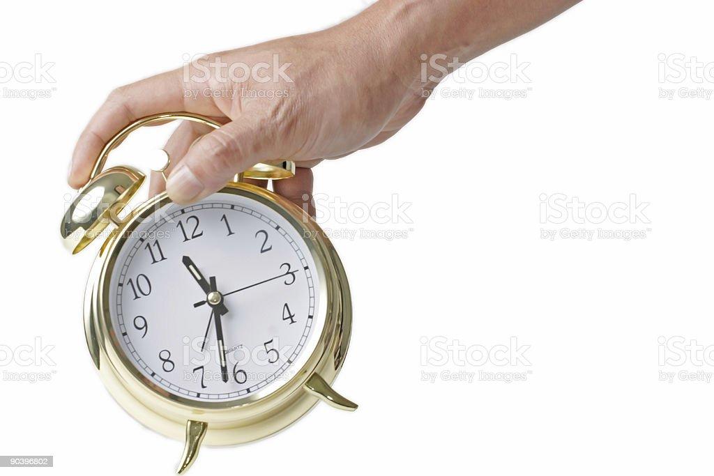 Hand holding alarm clock royalty-free stock photo