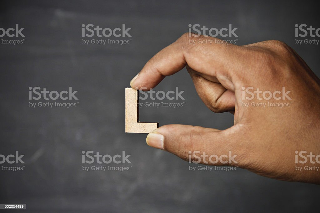 Hand holding alphabet stock photo