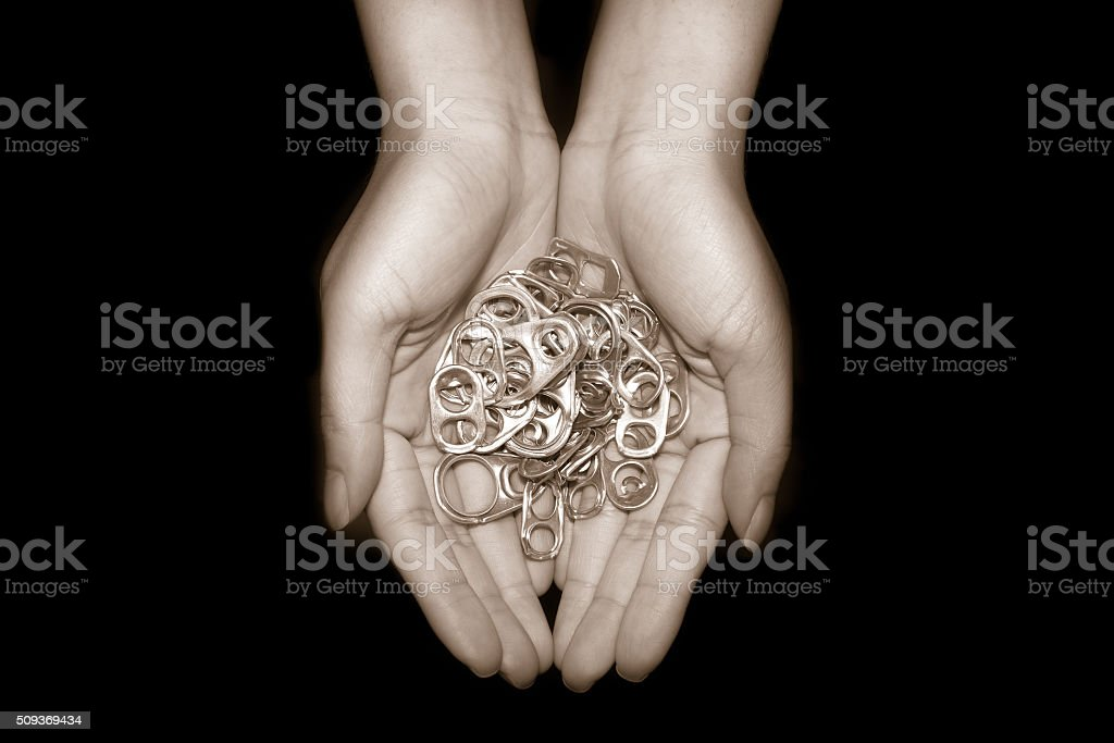 Hand holding aluminum cap can stock photo