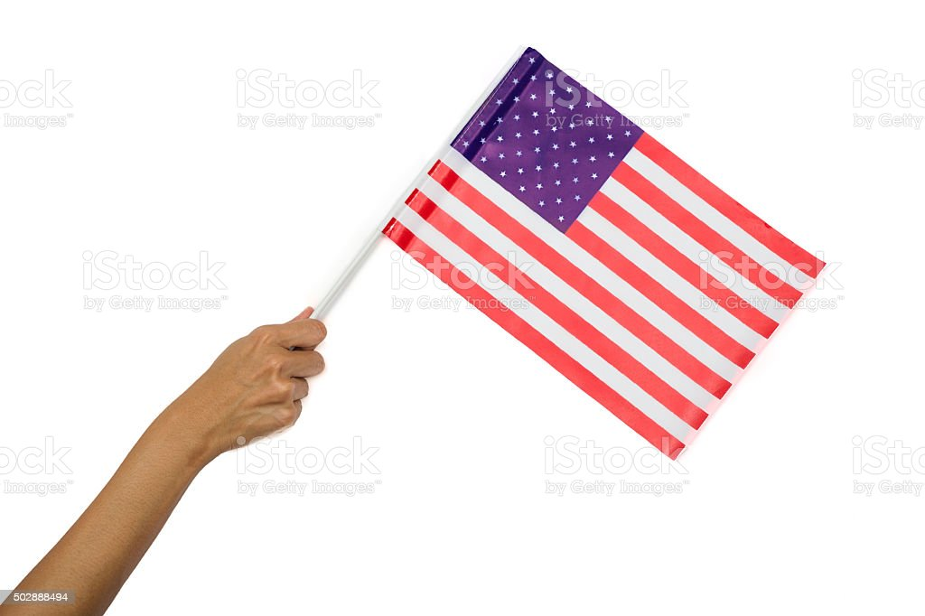 Hand holding American flag isolated on white background stock photo