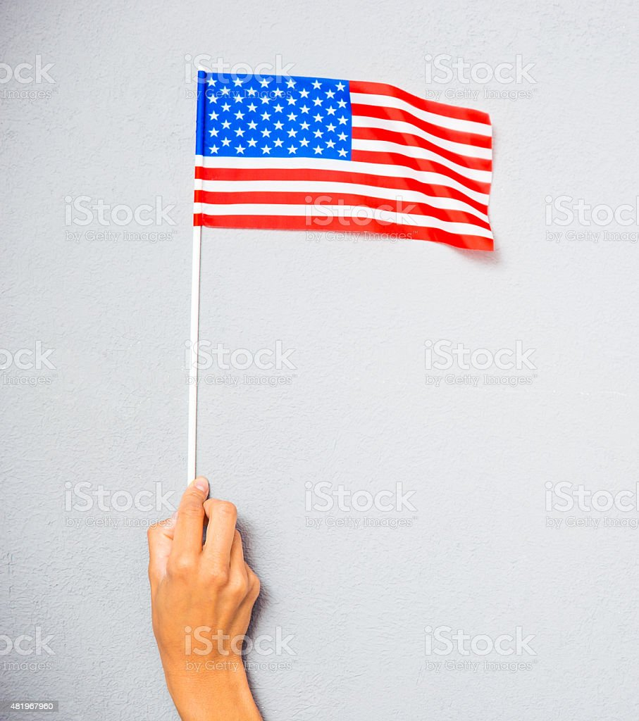 Hand holding american flag stock photo