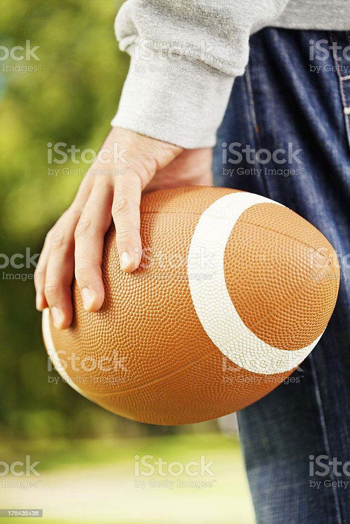 Hand Holding an American Football stock photo