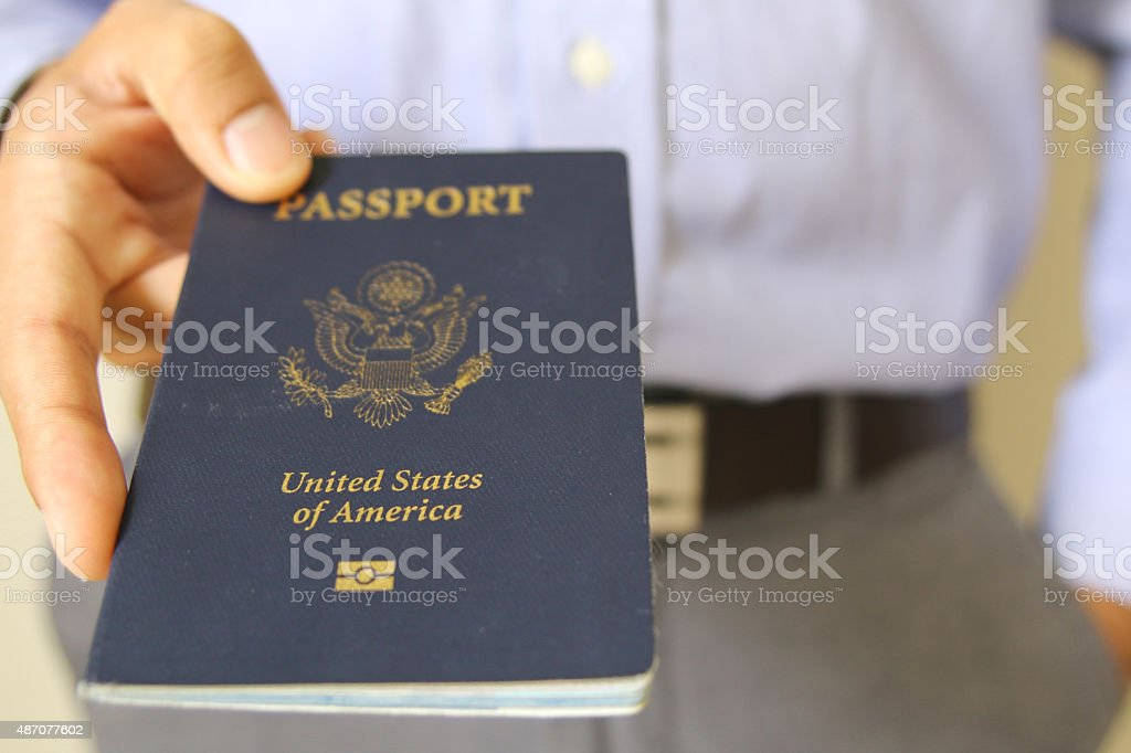 Hand Holding an American Passport Isolated stock photo