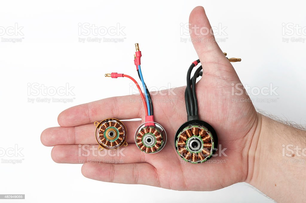 Hand holding an electrical motors stock photo