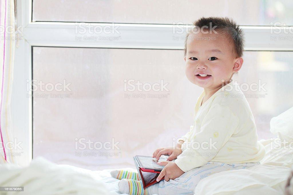 Hand holding an iPad mini baby smiling royalty-free stock photo