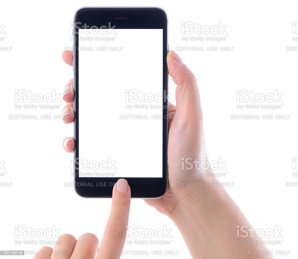 Hand holding and touching iPhone 6 Plus stock photo