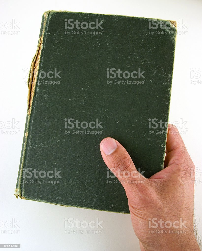 Hand Holding Antique Book royalty-free stock photo