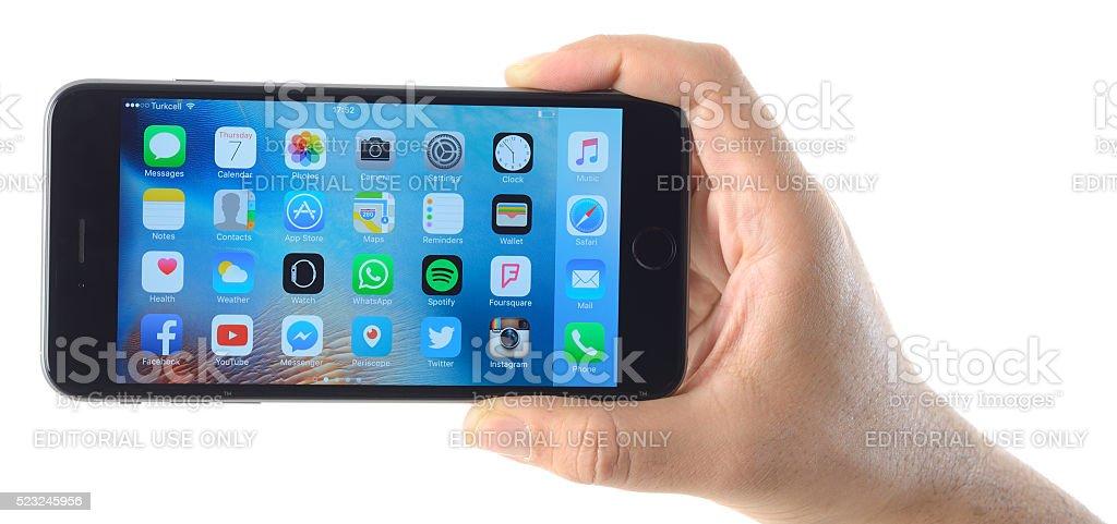 Hand holding Apple iPhone 6 Plus stock photo