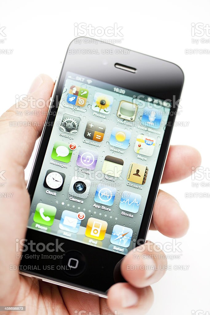 Hand holding Apple iPhone royalty-free stock photo