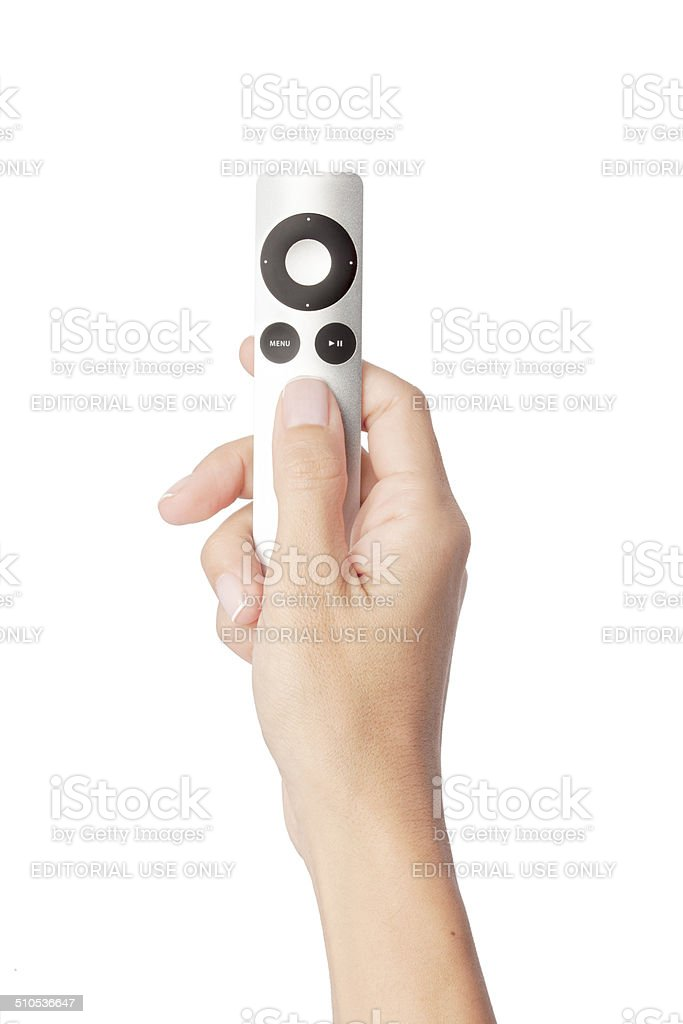 hand holding apple tv remote control stock photo