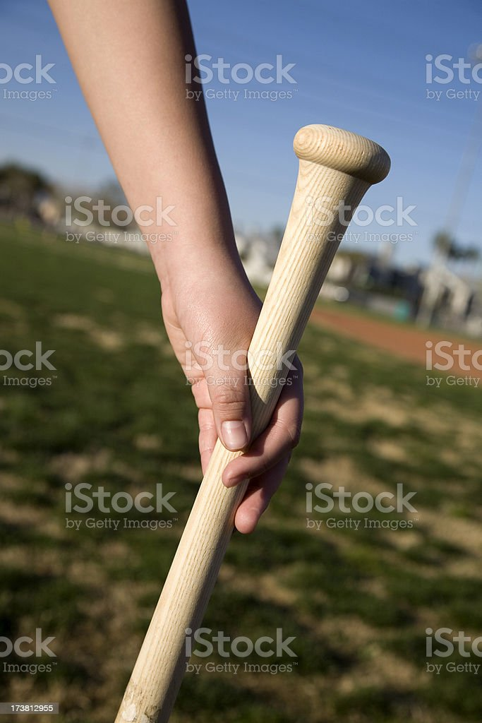 hand holding baseball bat royalty-free stock photo