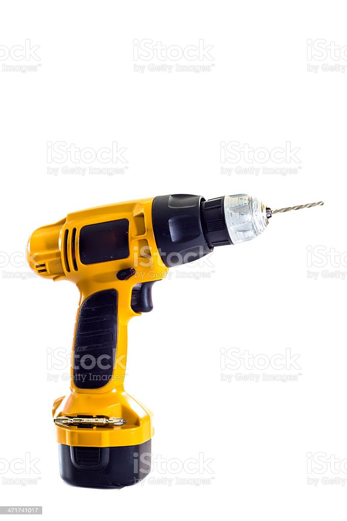 hand holding battery drill and drills wooden board, isolated royalty-free stock photo
