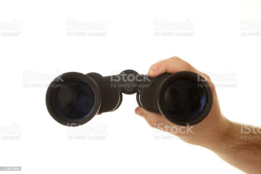 Hand holding binoculars stock photo