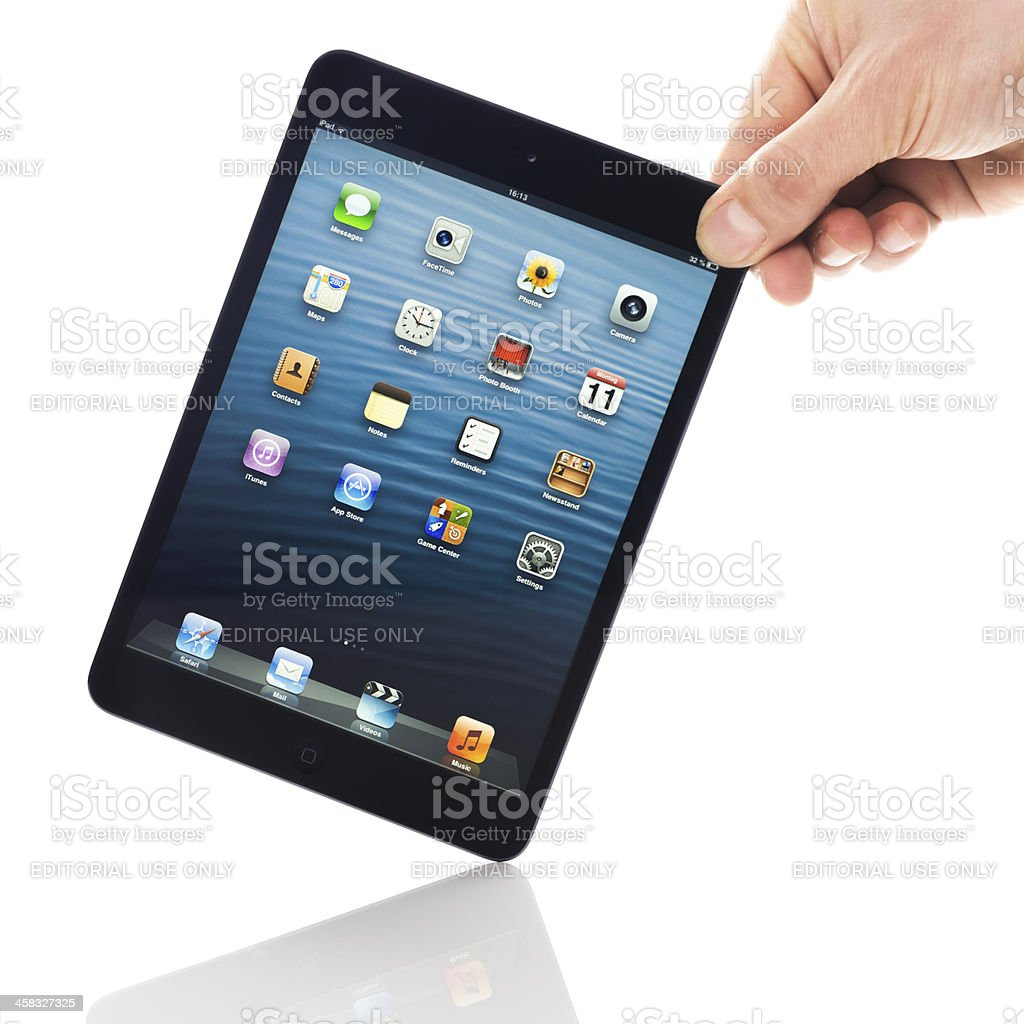 Hand Holding Black iPad mini royalty-free stock photo