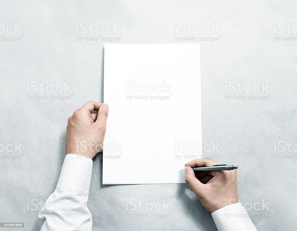 Hand holding blank agreement mockup and signing it. stock photo