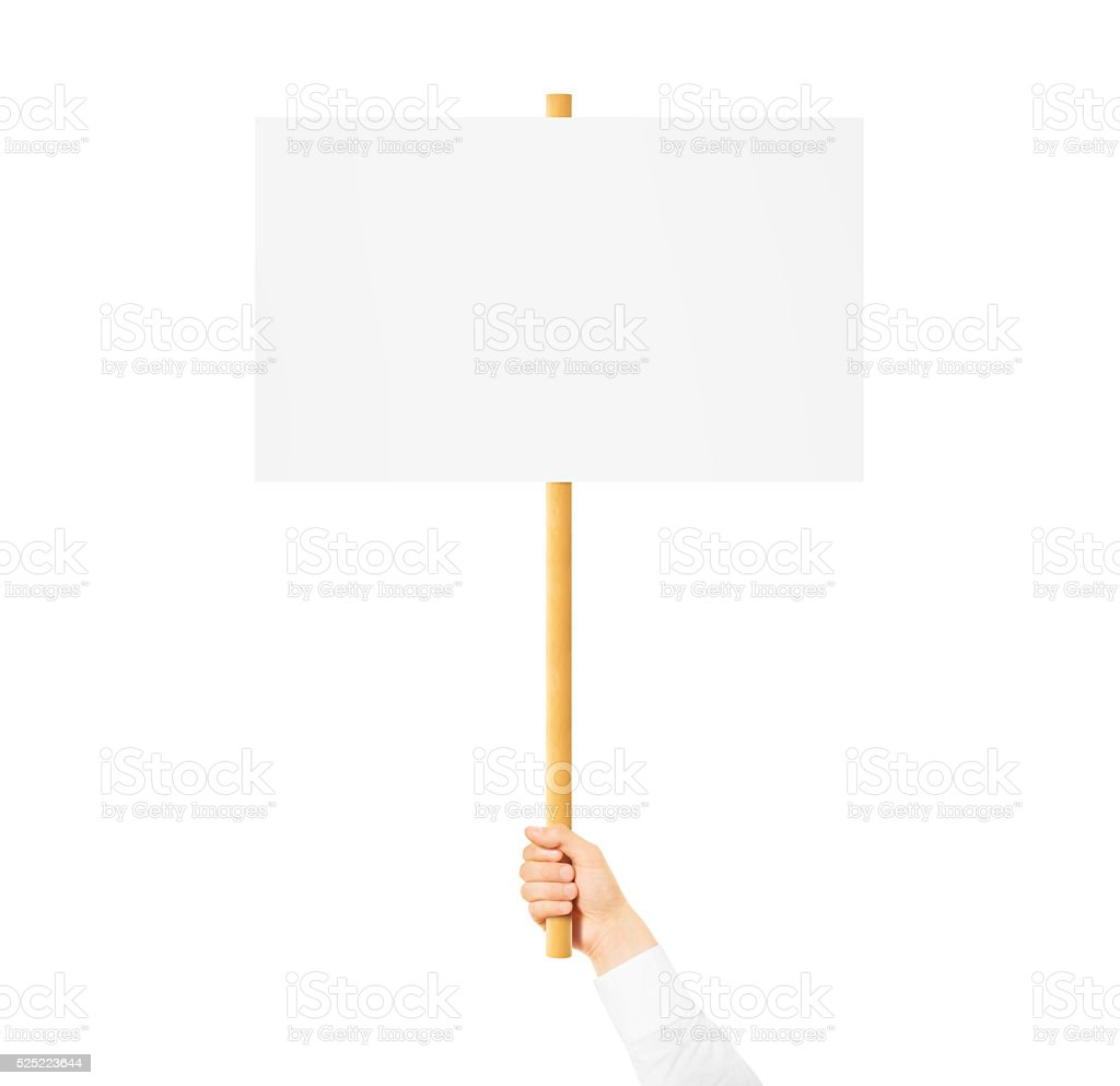 Hand holding blank banner mock up on wood stick isolated stock photo